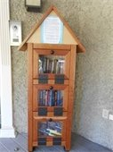 Book library in little wooden house