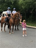 Child petting horse of U.S. Park Police on Mounted Horses