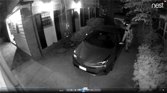 Thief on Grafton St. in Chevy Chase with hand on residents car door