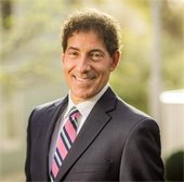 Image of Jamie Raskin in grey suit and pink striped tie
