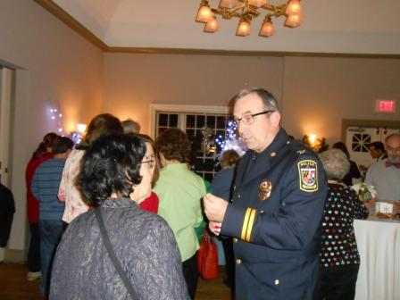 Uniformed officer in conversation with attendee