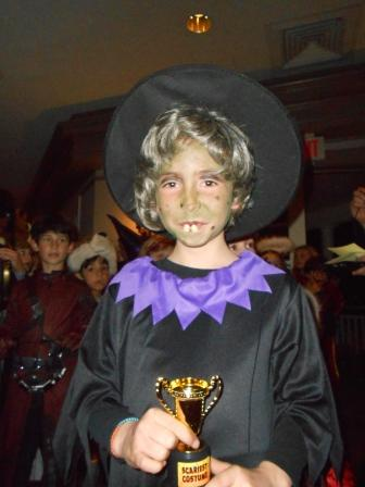 Young person dressed as a witch