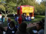 Attendees gathered near inflatable play structure