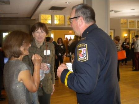 Uniformed officer conversing with attendees