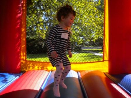 Young person enjoying inflatable play structure