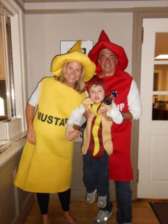 People dressed as ketchup mustard and hot dog