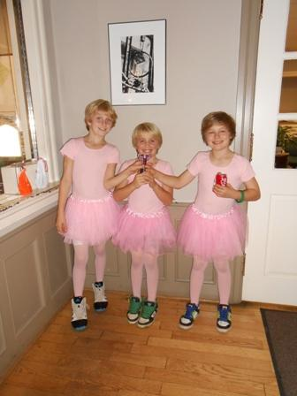 Three youths in pink costumes