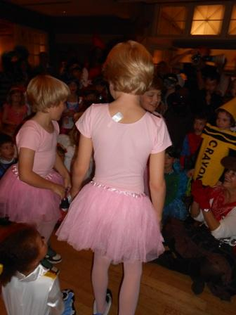 Two youths in pink costumes