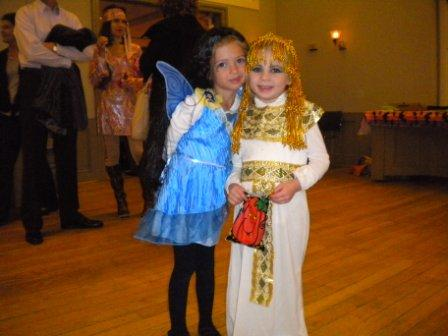 Two young people in costumes