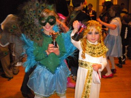 Young costumed individuals with awards