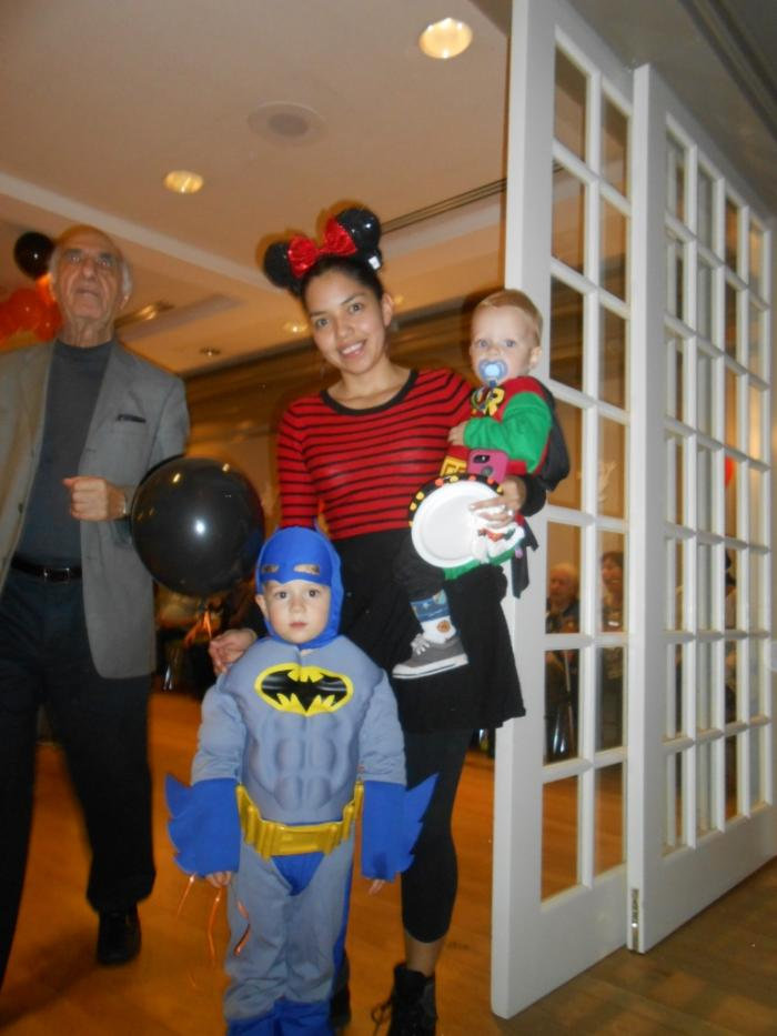 Three party attendees in costume