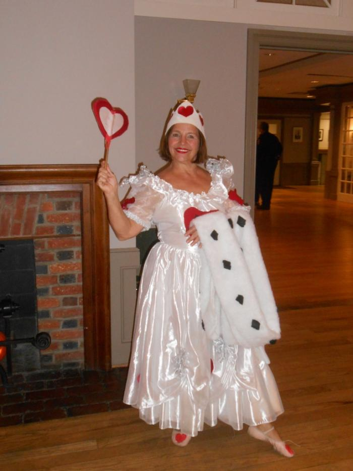 Woman dressed as Queen of Hearts