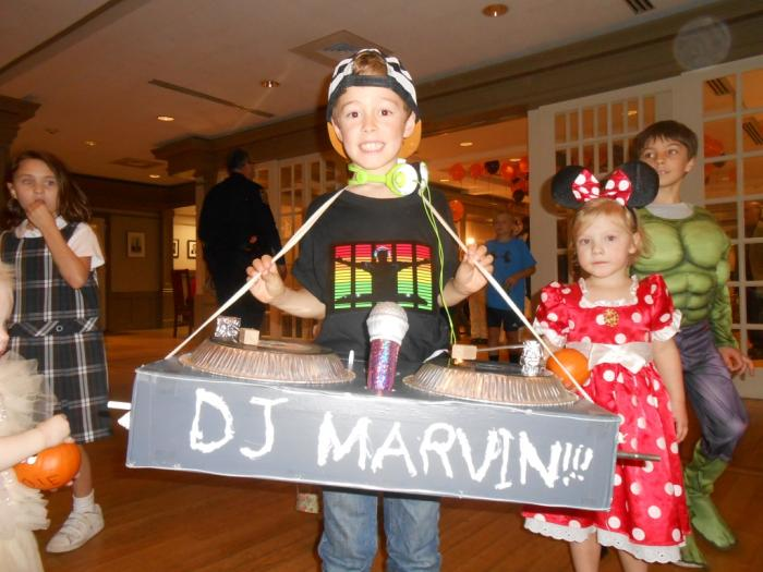 Young person dressed as DJ