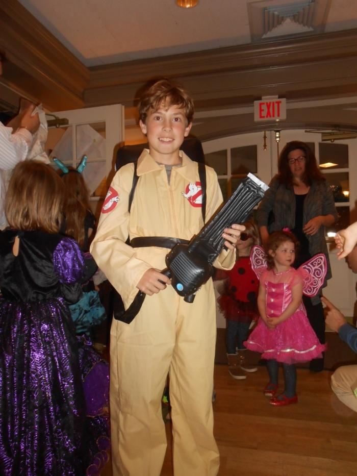 Young person dressed as Ghostbuster