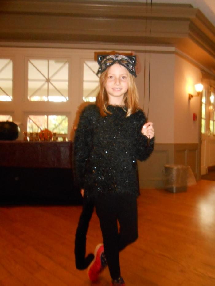 Young person dressed as cat