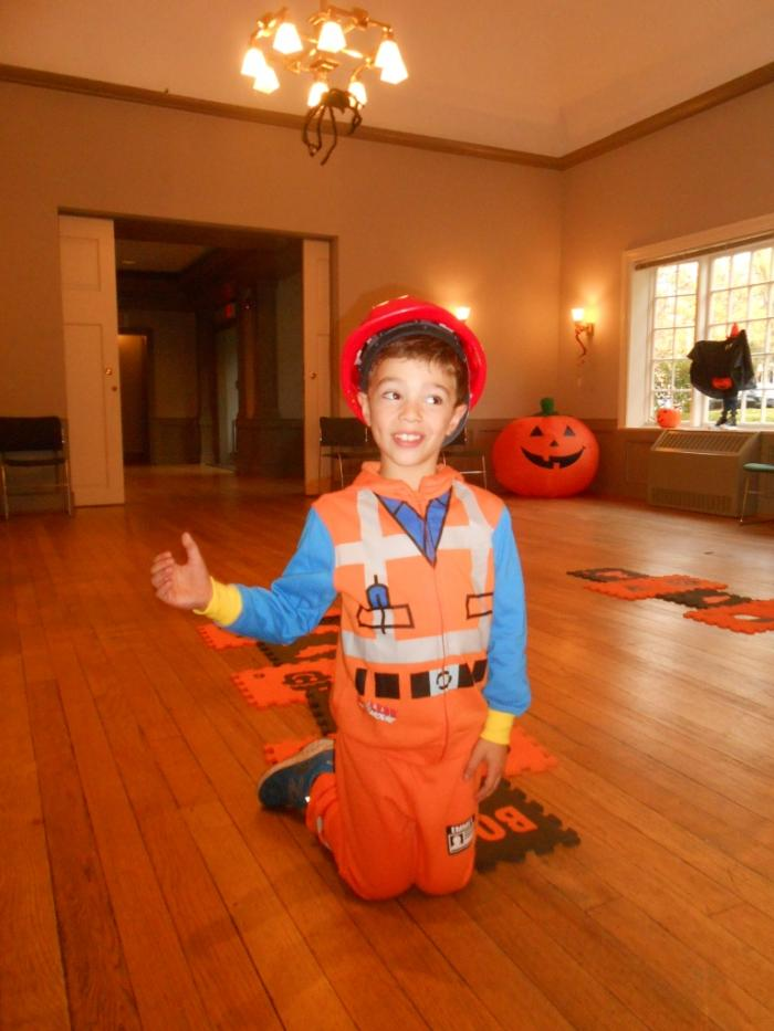 Young person dressed as construction worker