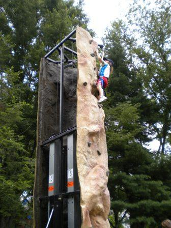 Person attempting climbing wall