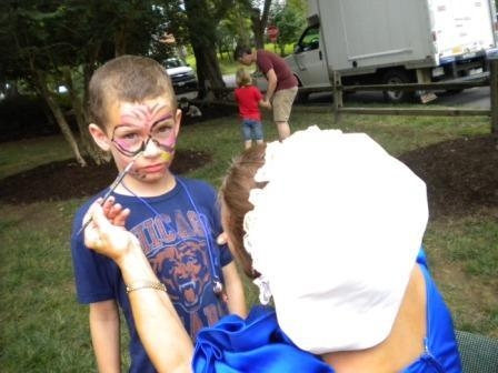 Youth having face painted
