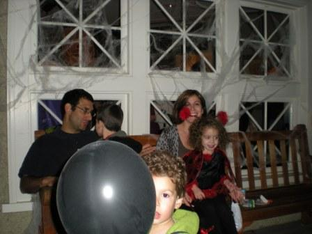 Black balloon and costumed attendees