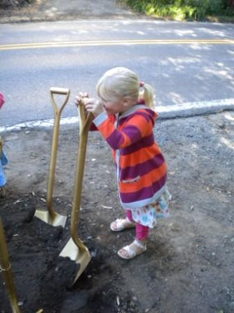Young person with shovel