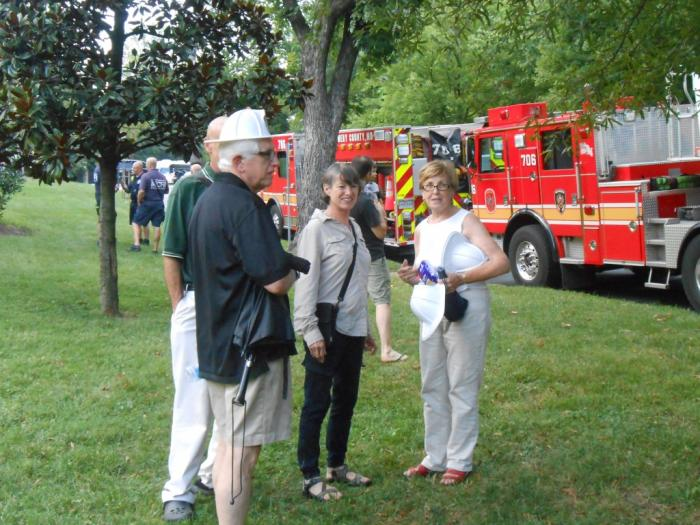 Event attendees with fire trucks