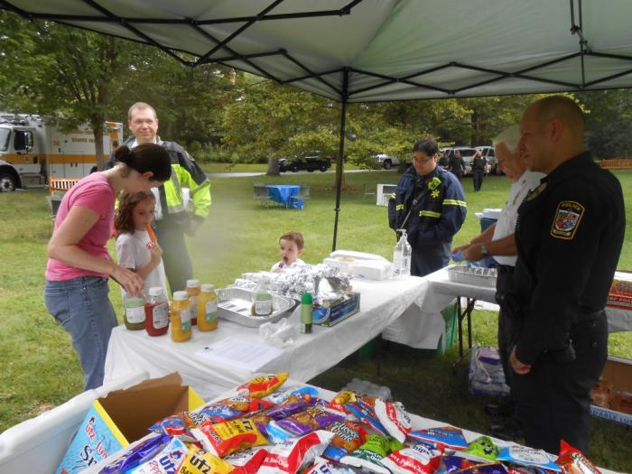 Officers and attendees get food