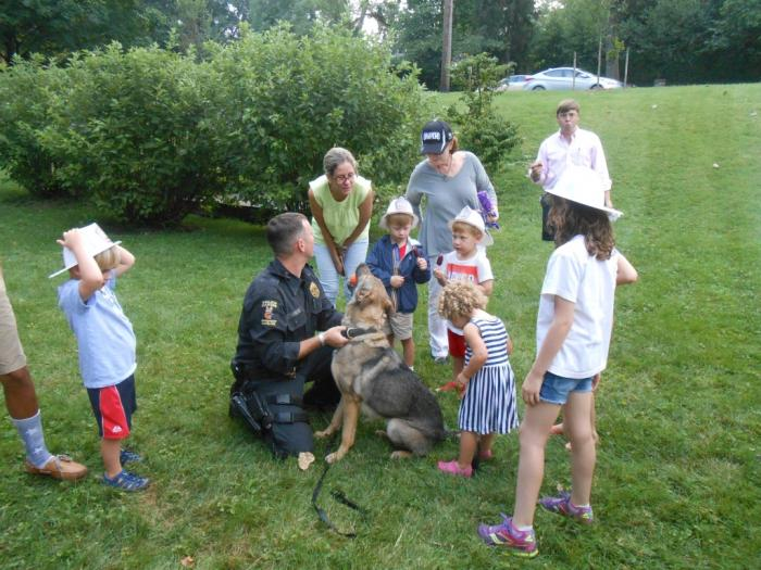 Police dog and group of attendees