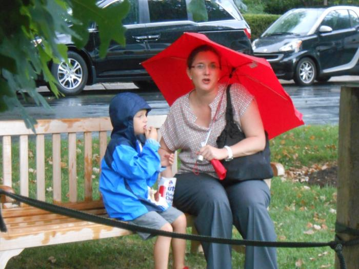 Woman and child with red umbrella