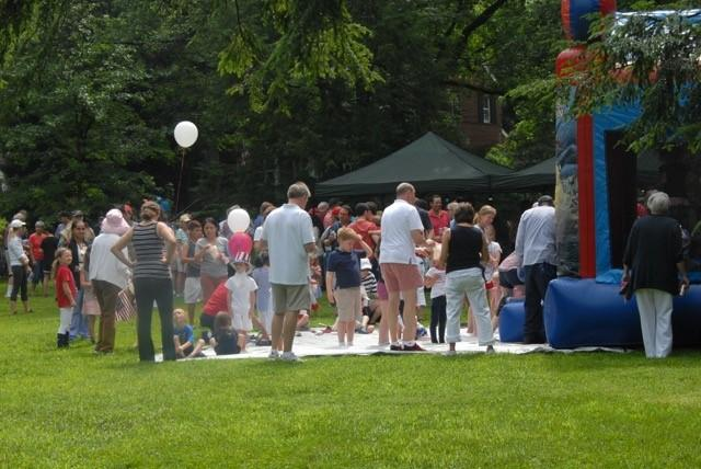 People gathered around inflatable play house