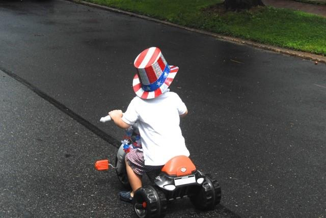 Young person riding tricycle