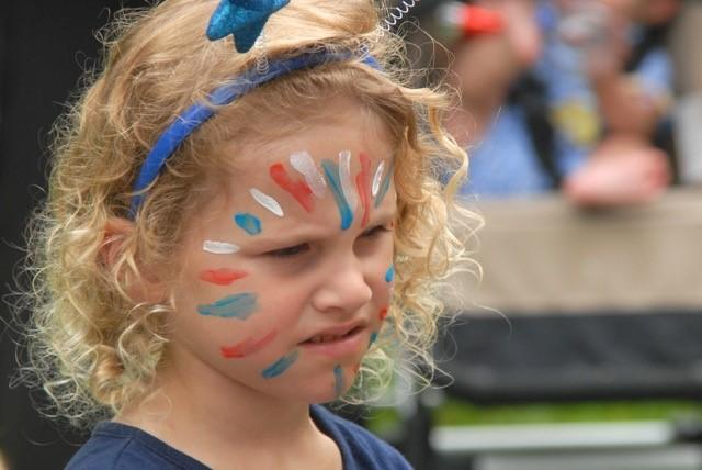 Young person with face paint